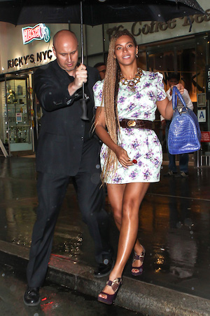 Beyonce and Jay-Z leaving an office building together braving the rain in NYC