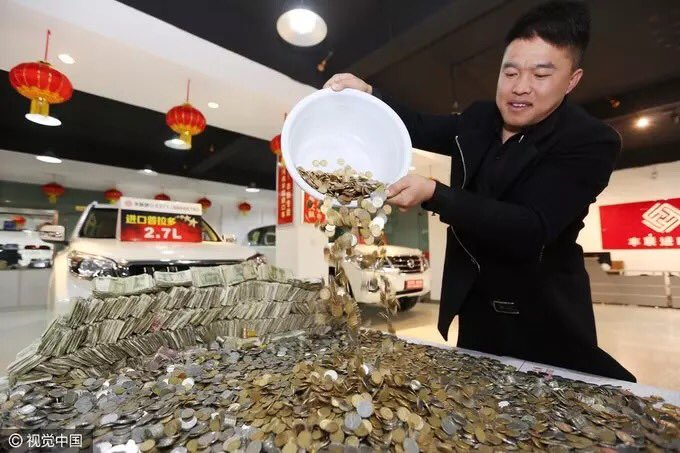 Photos: Chinese Man Brings Coins To Buy An SUV, Takes 4 Staff 12 Hours To Finish Counting