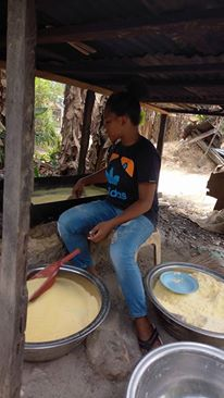 Photos: Meet Nigerian Lady, Emasoga Priscilla Who Processes Cassava Into Garri For A Living