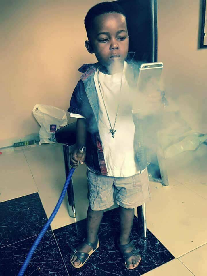 Photos: Nigerian Man Posts Photo Of His 5year Old Son Smoking Shisha And Defends His Actions