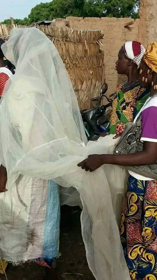 Bride Wears Mosquito Net, Empty Bag Of Rice As Her Wedding Gown